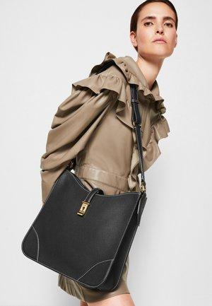 LAVYNIA SHOULDER BAG - Across body bag - black