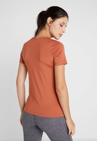 Nike Performance - ALL OVER - Basic T-shirt - dusty peach/echo pink - 2
