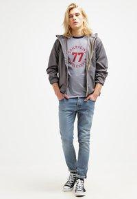 K-Way - CLAUDE UNISEX - Summer jacket - grey - 1