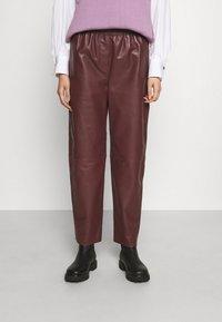 Marimekko - IHMETELLÄ TROUSERS - Leather trousers - wine red - 0