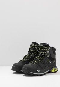 Millet - HIGHROUTE GTX - Walking boots - black/acid green - 2