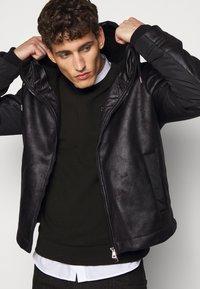 EA7 Emporio Armani - GIUBBOTTO - Leather jacket - black - 4
