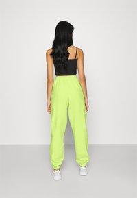 adidas Originals - PANT - Tracksuit bottoms - semi frozen yellow - 2