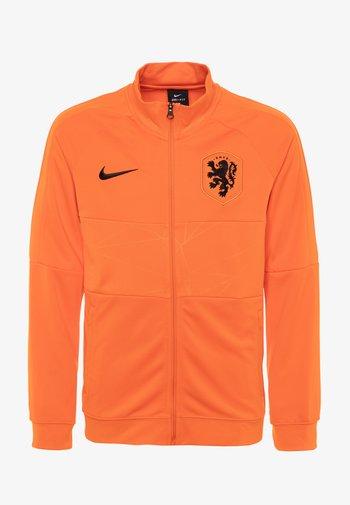 NIEDERLANDE ANTHEM  - Club wear - safety orange/black