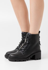 Mexx - FIRA - Lace-up ankle boots - black - 0