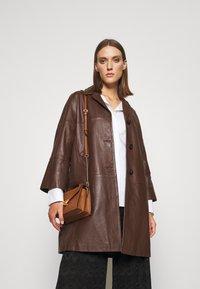 MICHAEL Michael Kors - GRACE XBODY - Handbag - brown - 1