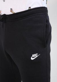 Nike Sportswear - CLUB JOGGER - Tracksuit bottoms - black - 3