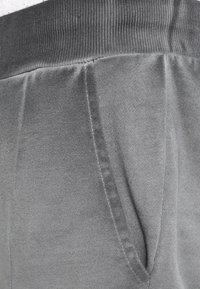 YOURTURN - Tracksuit bottoms - black - 3