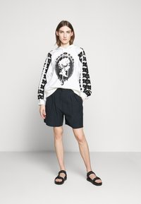 McQ Alexander McQueen - TROUSERS - Shorts - deep ink - 1