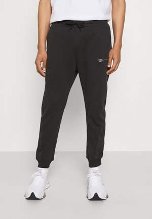 ASTRA WRAP SW PANT - Pantaloni sportivi - dark black