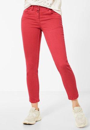 Slim fit jeans - light red