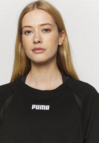 Puma - PAMELA REIF X PUMA BOXY TEE - T-Shirt print - black - 3