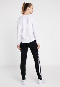 Limited Sports - SWEATPANT SAMU - Tracksuit bottoms - black/white - 2