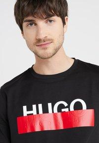 HUGO - DOLIVE - T-shirt con stampa - black - 3