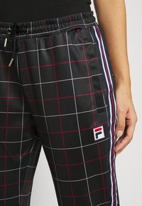 Fila Petite - WINTA CROPPED PANTS - Trousers - black