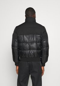 Calvin Klein Jeans - MATTE AND SHINE PUFFER - Winter jacket - black - 2