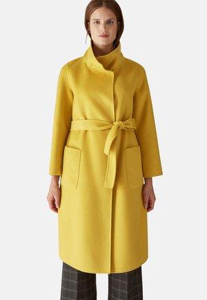 Trenchcoat - giallo