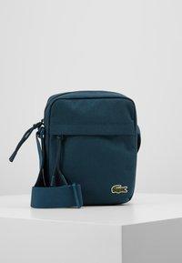 Lacoste - VERTICAL CAMERA BAG UNISEX - Camera bag - reflecting pond - 0