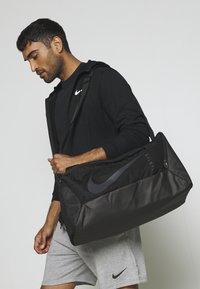 Nike Performance - DUFF UNISEX - Sports bag - black - 0