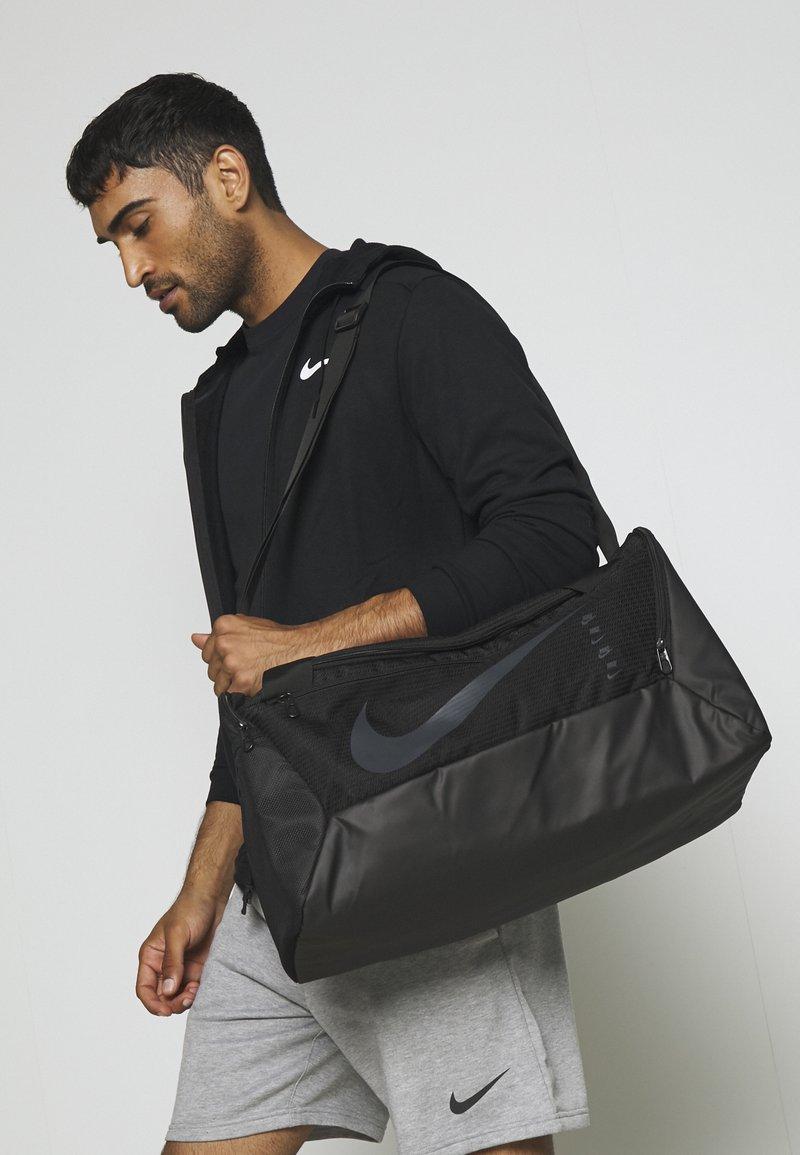 Nike Performance - DUFF UNISEX - Sports bag - black