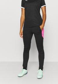 Puma - FTBLNXT PANTS - Leggings - black/luminous pink - 0
