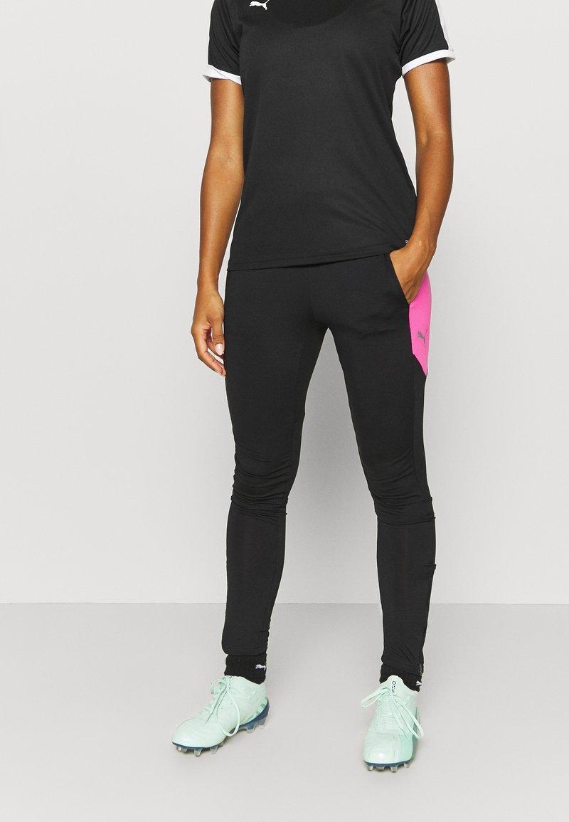Puma - FTBLNXT PANTS - Leggings - black/luminous pink