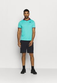 Craft - CORE CHARGE SHORTS - Sports shorts - black - 1
