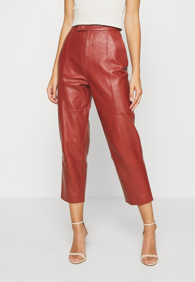 PIGEON - Leather trousers - tulip