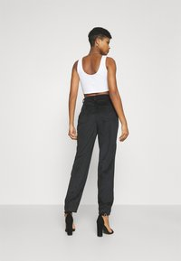 NA-KD - NARROW HEM TROUSERS - Trousers - black - 2