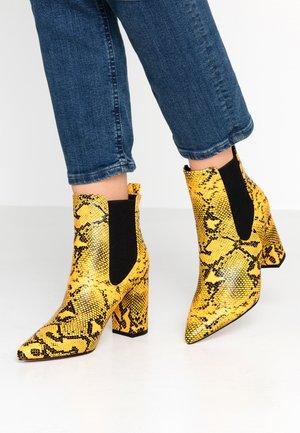 High Heel Stiefelette - yellow