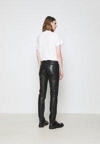 KARL LAGERFELD - PANTS - Spodnie skórzane - black - 2