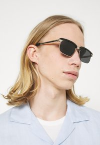 Salvatore Ferragamo - UNISEX - Sunglasses - black/gold-coloured - 1