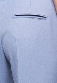 HUGO - HERLENE - Trousers - bright blue - 6