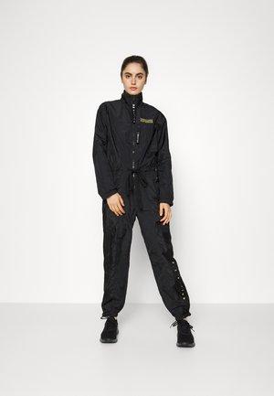 BOILERSUIT - Jumpsuit - black