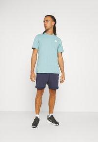 Fila - NOLAN SHORTS CROPPED - Sports shorts - black iris - 1