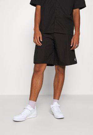 BOSTON - Shorts - black