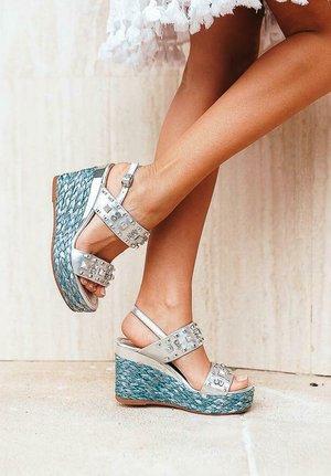 GINEBRA - Wedge sandals - blue