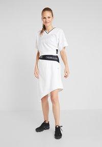 Calvin Klein Performance - ASYMMETRIC SKIRT - Sports skirt - white - 1