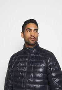 Norrøna - LIGHTWEIGHT JACKET - Down jacket - black - 3