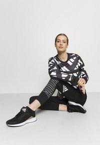 adidas Performance - CELEB - T-shirt sportiva - black/white - 1