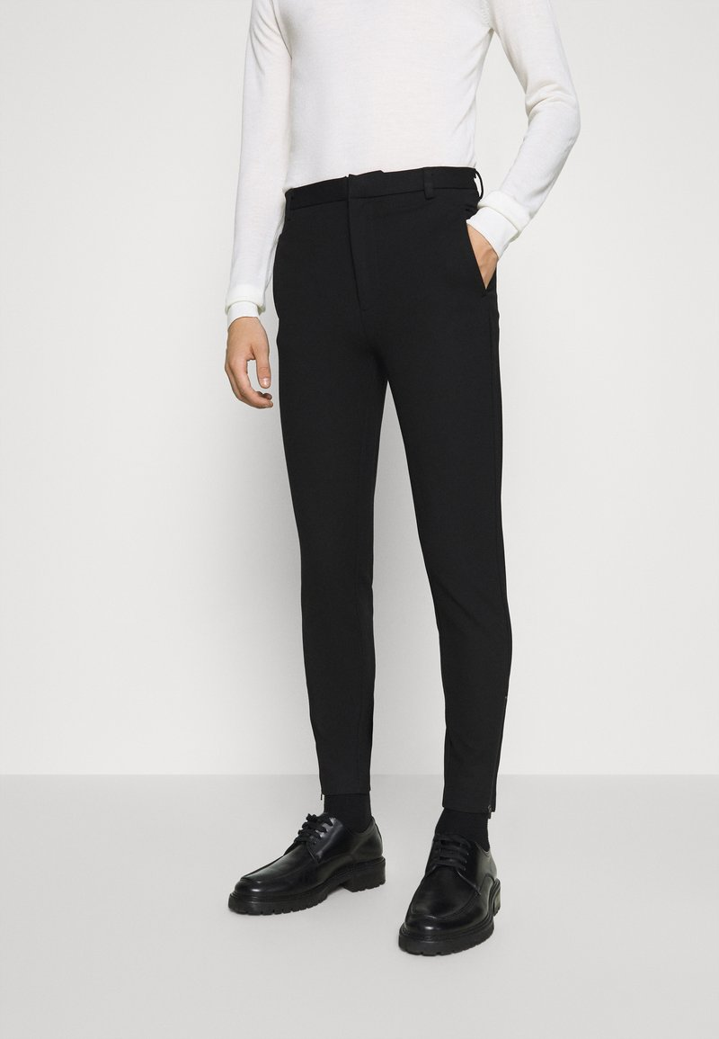 Bruuns Bazaar - POLITAN ZIP PANTS - Trousers - black