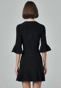 FELIPE ALBERNAZ - Day dress - black - 1