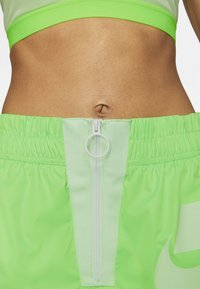 Nike Sportswear - Tracksuit bottoms - green strike/vapour green/white - 2