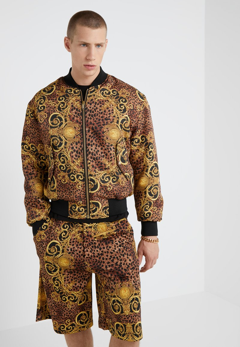 Versace Jeans Couture - GIUBBETTI UOMO - Bomber Jacket - gold