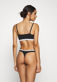 Calvin Klein Underwear - THONG 2 PACK - String - black - 2