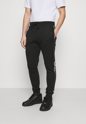 CHEVRON JOGGER - Tracksuit bottoms - black/white