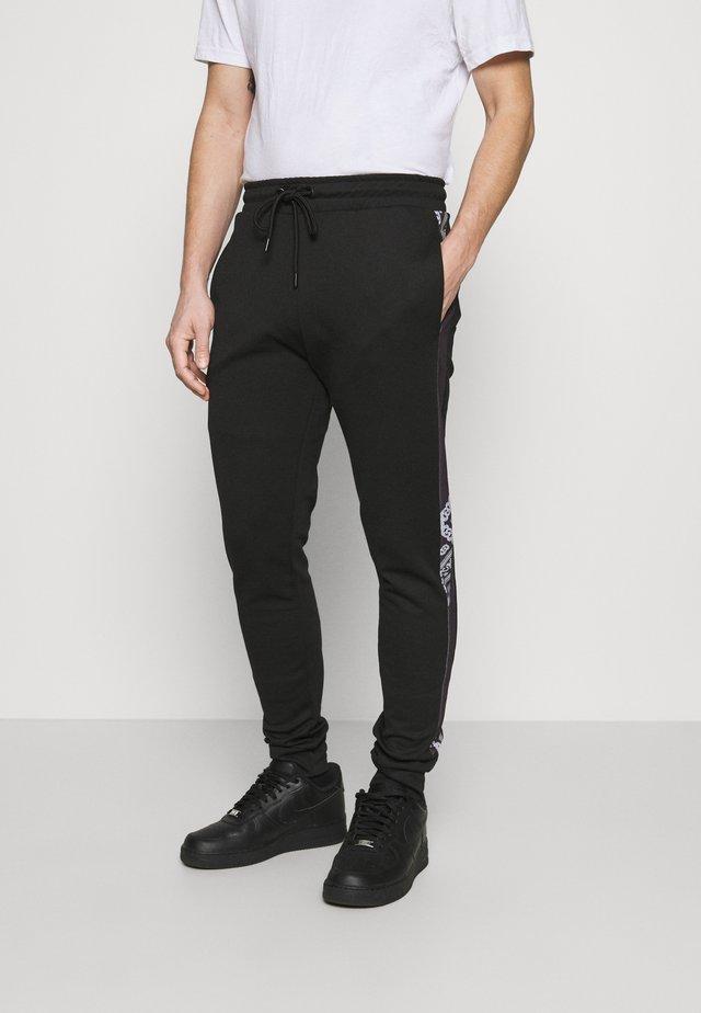 CHEVRON JOGGER - Pantaloni sportivi - black/white