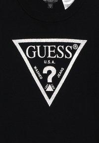 Guess - JUNIOR DRESS - Sukienka dzianinowa - jet black - 3