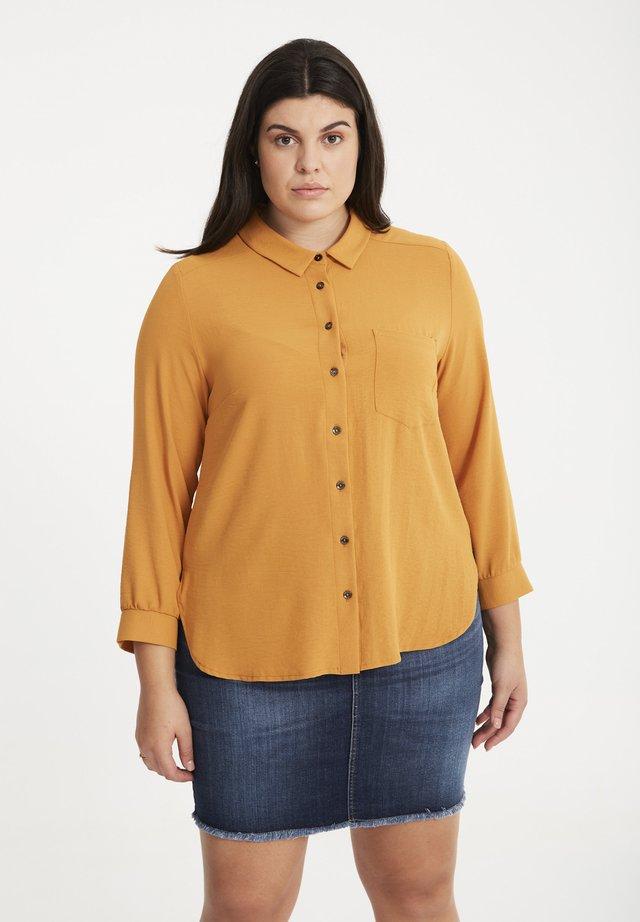 Overhemdblouse - caramel