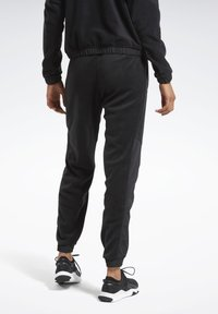 Reebok - MYT WARM-UP JOGGERS - Tracksuit bottoms - black - 2